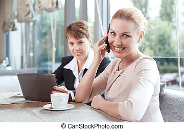 Businesswomen during a business lunch - Portrait of a...