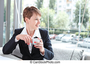 Businesswoman on a break - Portrait of a beautiful...