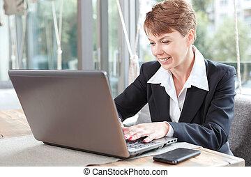 Businesswoman on a break - Portrait of a beautiful...
