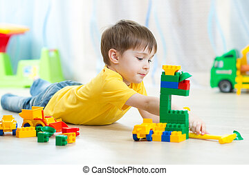 kid playing toy blocks at home