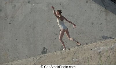young graceful ballerina who dances - Video footage of the...
