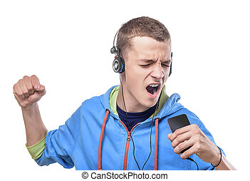 Young man listening music - Attractive young man sing and...