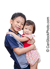 Young brother holding his sister