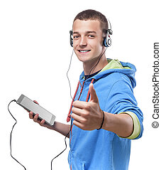 Guy using phone with headphones - Handsome guy using tablet...