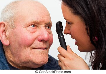 Elderly Man With Vision Problems - Elderly man at the...