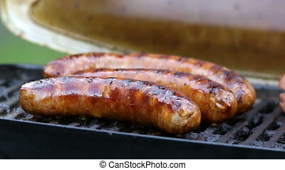 Close up from sausages on grill