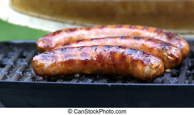 sausages is turn on grill