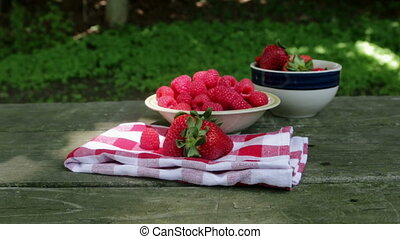 Moving to raspberries on table slow motion