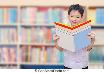 schoolboy reading book