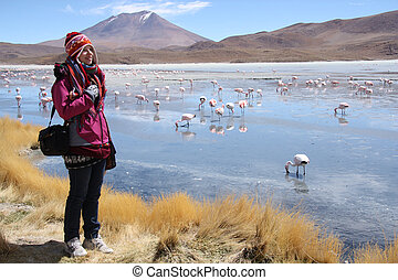 Woman tourist at the mountain lake