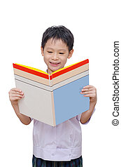 schoolboy in uniform reading book