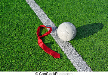Soccer Ball and Tie - Soccer ball and tie on a soccer field...