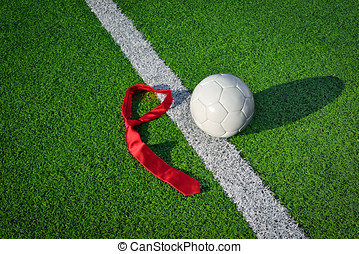 Soccer ball and tie on a soccer field