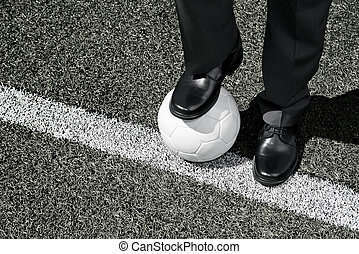 Manager with Soccer Ball - Manager with soccer ball on the...