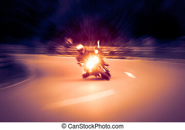 Motorcycling - Motorcyclist is taking a corner at high speed