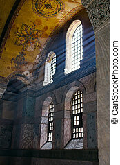 Sun rays beaming through the old stained glass window.