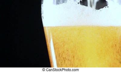 Beer in a Glass. The Black Background is Insulated - Beer is...