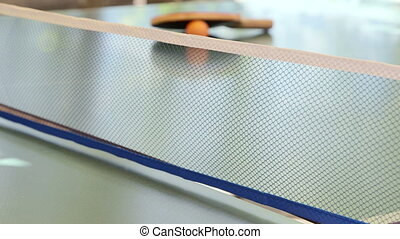 Playing table tennis game outdoor close-up