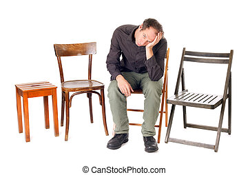 alone sad man - sad man sit on chair and thinking about...