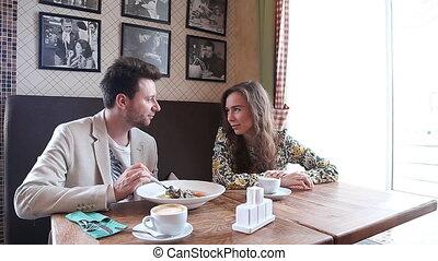 Flirting couple in cafe - Flirting  couple speak in cafe