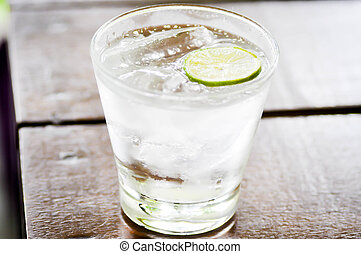 tonic,soda and lime slice - a glass of soda and lime slice