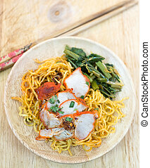 Chinese egg noodles with red pork and vegetables
