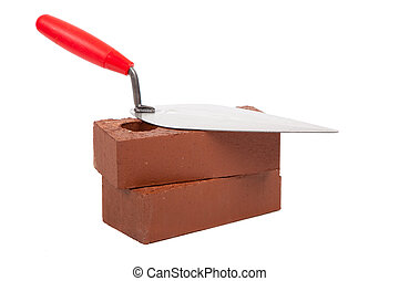Stack bricks with trowel on a white background