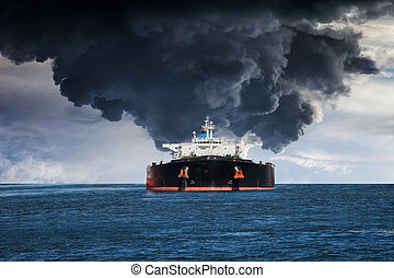 Burning ship - Burning Tanker ship on the sea.