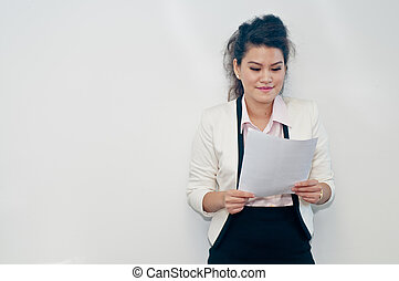 Woman holding business contract on white background