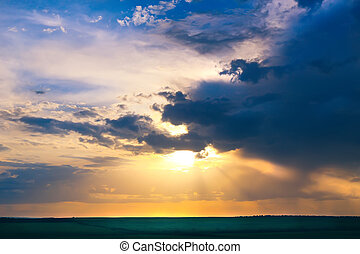 bright sunset in cloudy sky - beautiful bright sunset in...