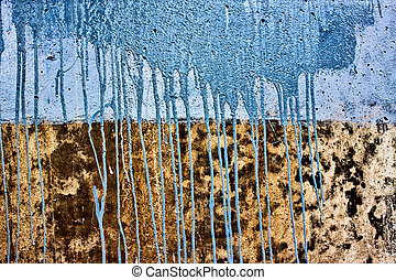 concrete wall with drips of blue paint