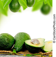 Avocado - Photo of avocado with leaves and slice with white...