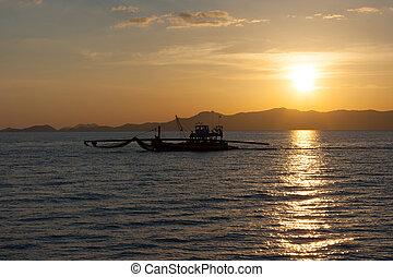 Fishing boat professional tuna catch fishery sunset backlight