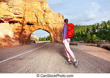 Girl walking on the road with Red canyon view