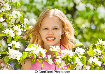 Blondie teenager girl with white pear tree flowers - Blond...
