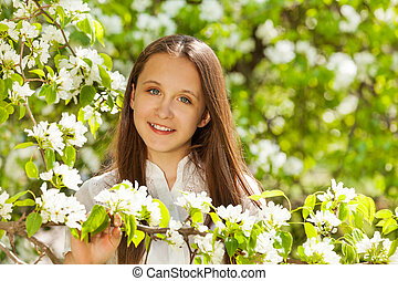 Close-up view of teenager girl with white flowers - Close-up...