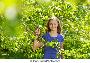 Portrait of beautiful teenager girl with pear tree -...