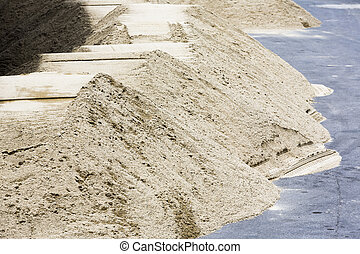 Piles of sand - Construction sand piles on the road near...