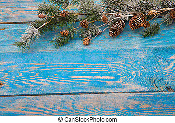Christmas background with fir branches,pinecones and berries...