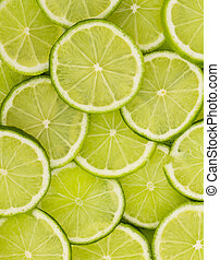 lime slices - Green background with citrus-fruit of lime...