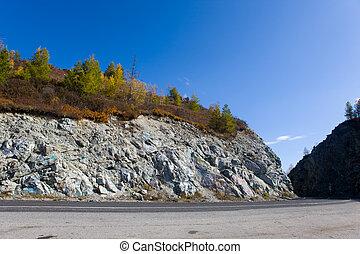 mountain pass - Road through mountain pass in autumn day