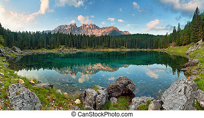 Panorama of Alps lake landscape with forrest mountain, Lago...