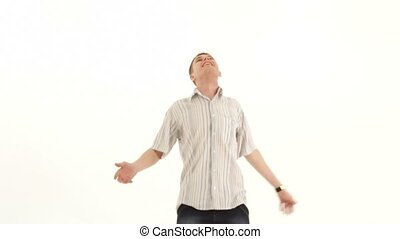 Man Throws Pieces Of Paper - SLOW MOTION. A young man throws...