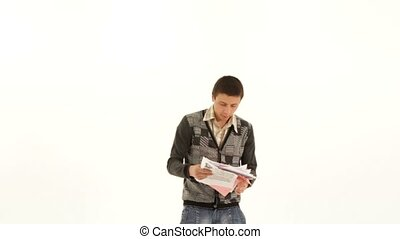 Throw Out The Paper - A young man throws a folder with white...