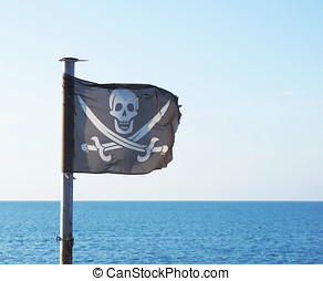 Pirate flag with skull and crossed swords fluttering in the...