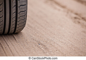 trace of rubber tires SUV in the desert sand. Riding a four-wheel drive vehicles passable attracts many tourists and professionals