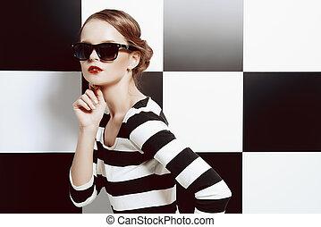 chessboard - Beautiful fashion model posing in dress in...