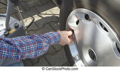 Car Care - Checking the Tire Pressu - Checking the tire...