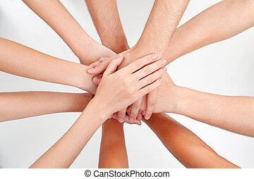 Top view of putting hands on each other - Unity of friends....