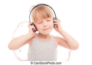 Pretty little girl listening to music - Feel the melody....